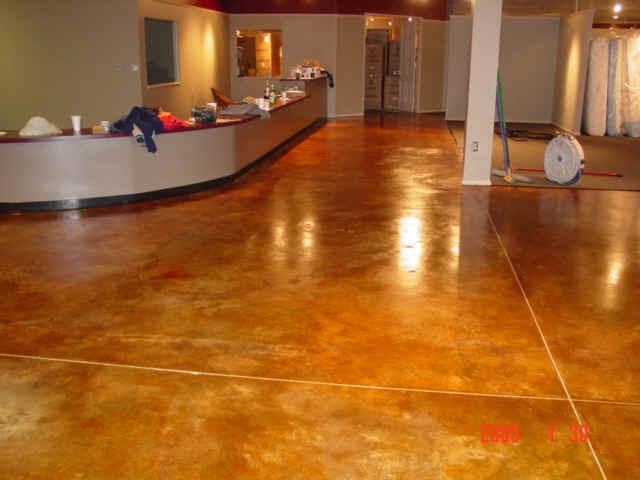 Acid stained concrete office building entry floor for How to clean concrete floors before staining